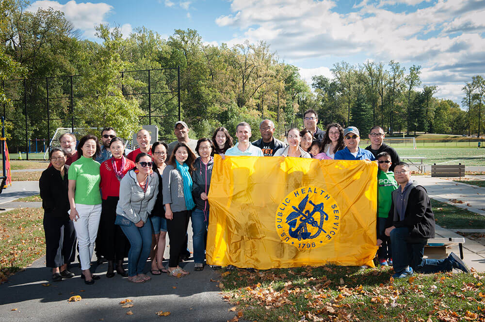 Group of people holding a US Public Health Service Flag flag