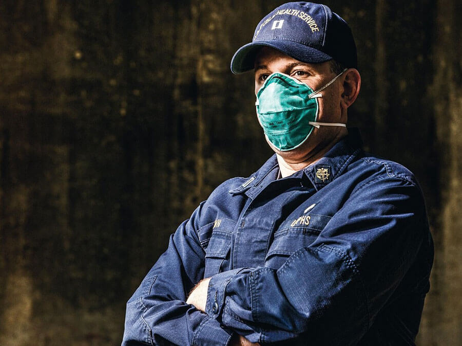 US public health service member with hat and mask on