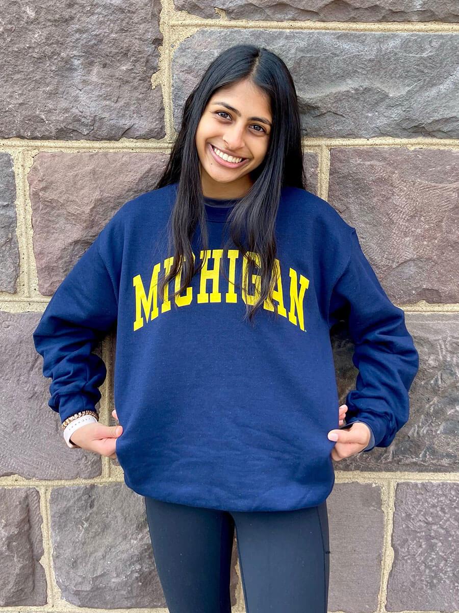 girl smiling in Michigan shirt